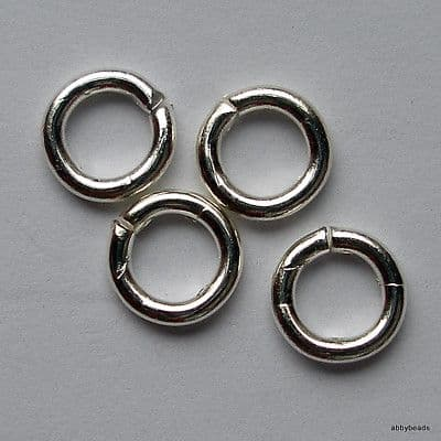 "6mm Jump rings Silver plated on brass wire ""open"". Per 100"