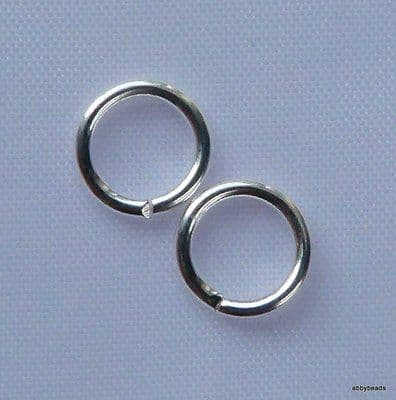 """8 mm Jump rings Silver plated on brass wire """"open"""". Per 100"""