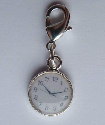 Clip on charm for bracelet or hand bag. Clock face.