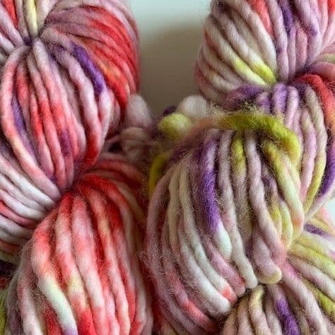 Pure merino chunky in muted red, blue and purple