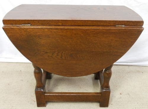 sold - Solid Oak Oval Dropleaf Coffee Table